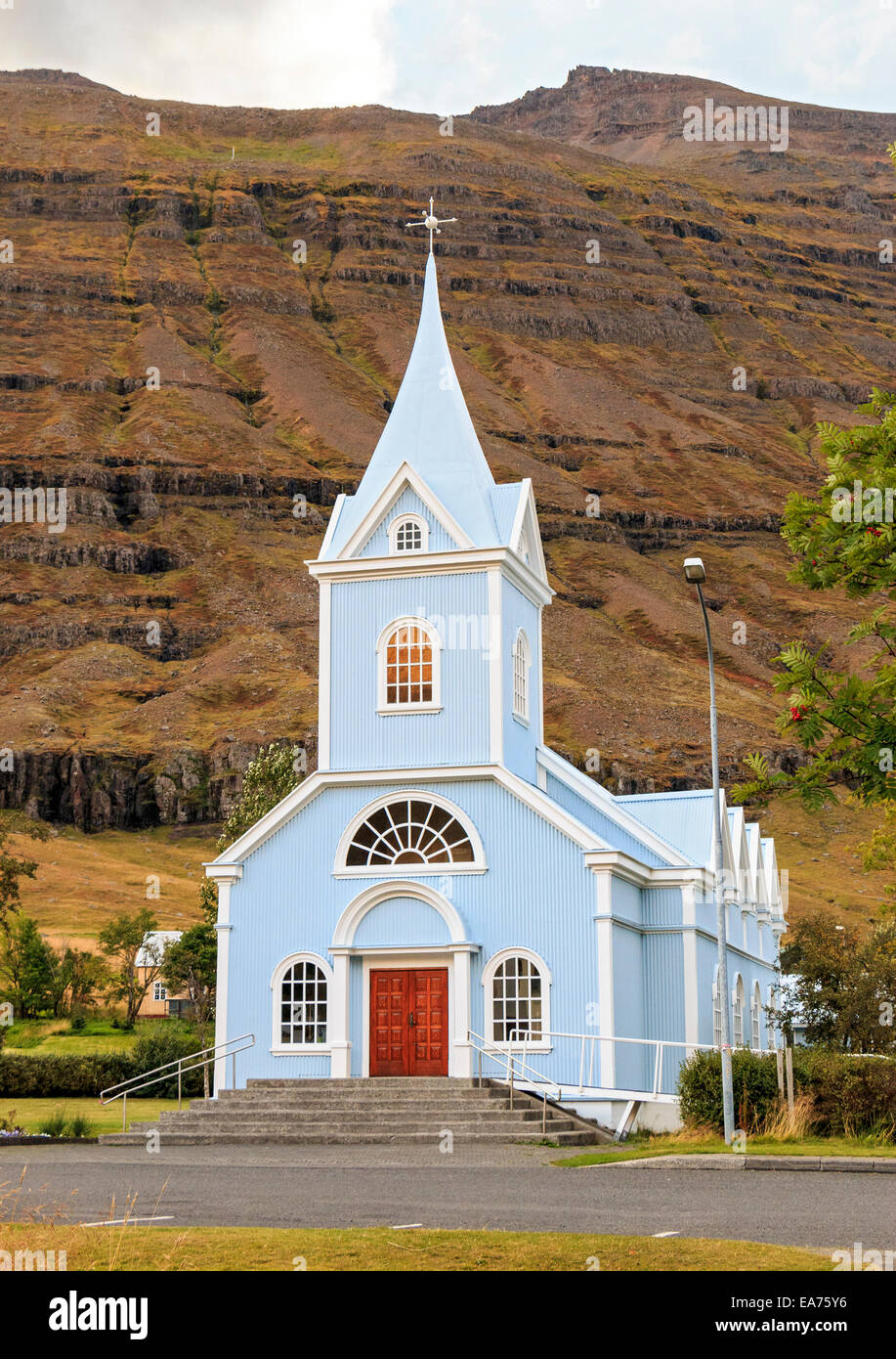 Church in the eastern Iceland town of Seydisfjordur. Locals call it simply Seydisfjordur Church and also, the Blue - Stock Image
