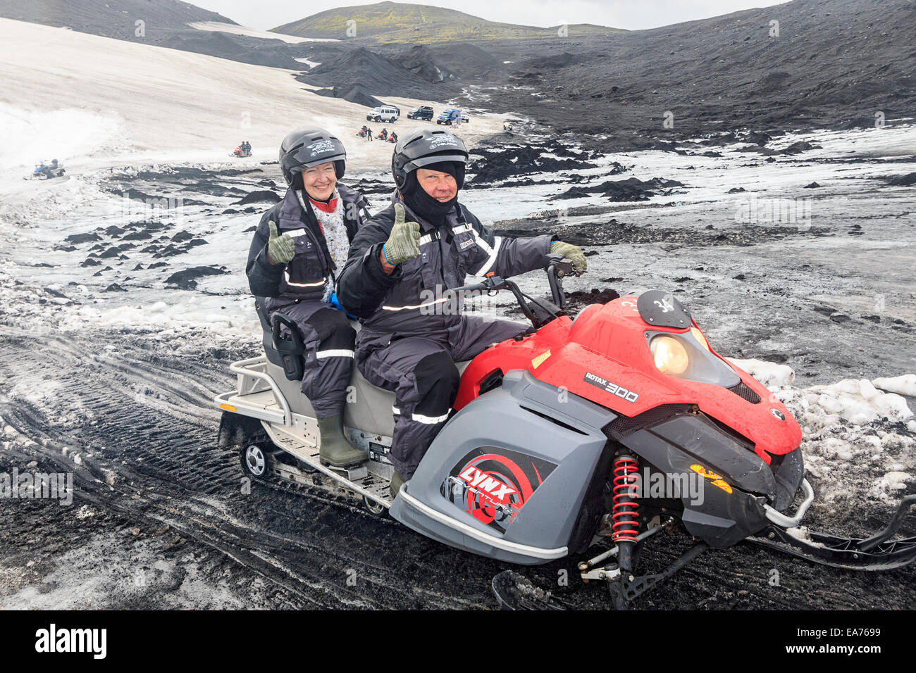 Snowmobiling on Mýrdalsjökull, a glacier in the south of Iceland. - Stock Image
