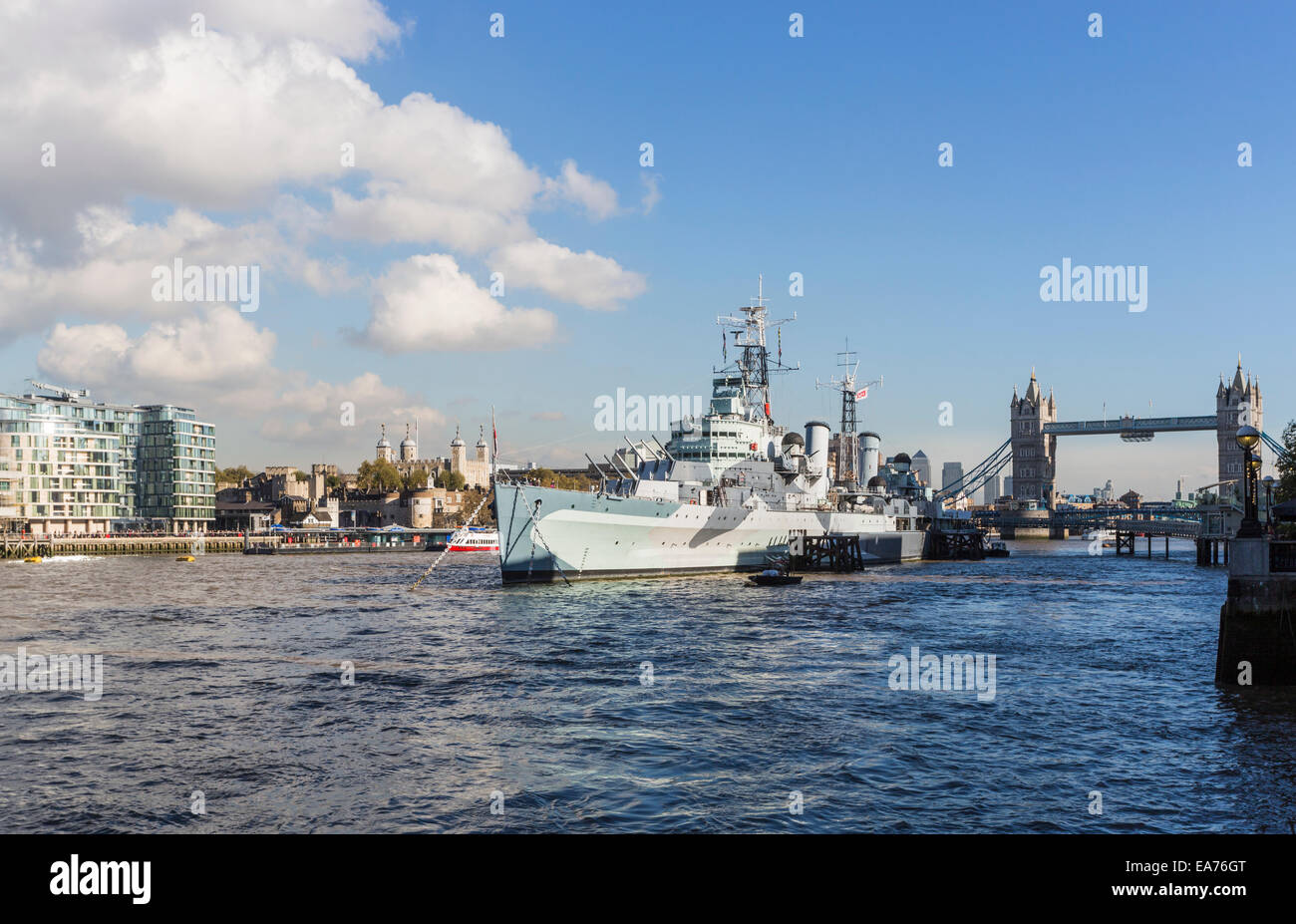 HMS Belfast, the iconic WWII cruiser moored at Queen's Walk on the River Thames, London, now a popular museum - Stock Image