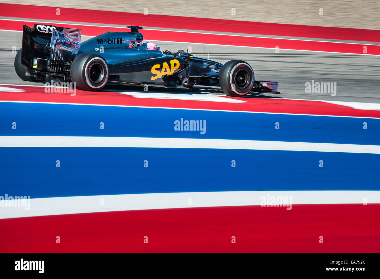 Jenson Button of McLaren during practice for the 2014 United States Grand Prix at Circuit of the Americas. - Stock Image