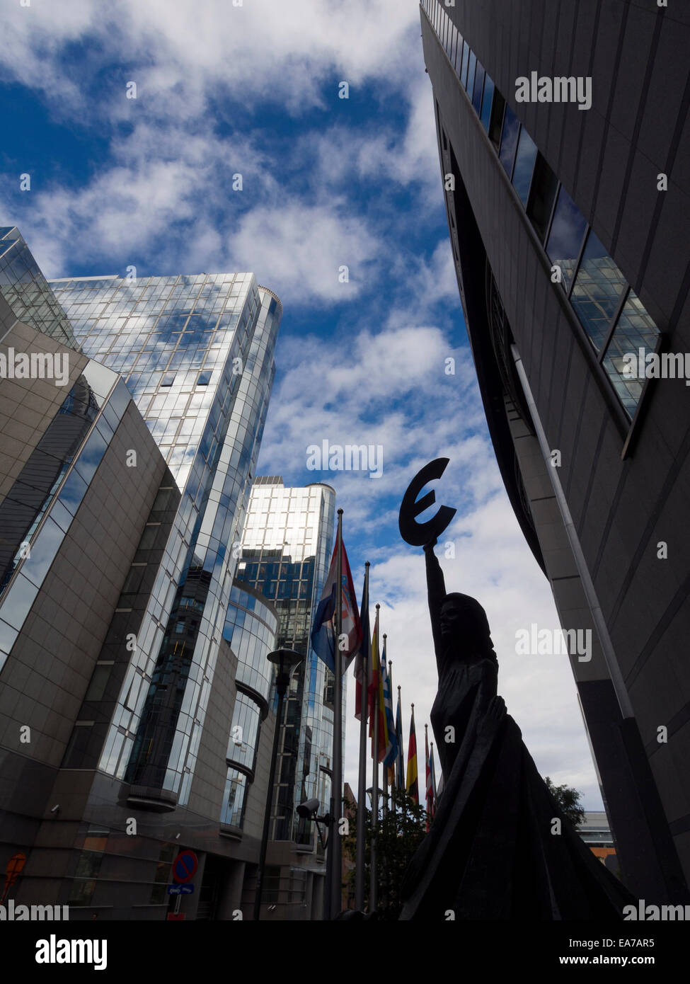 'Europe' statue of a woman holding the Euro symbol next to the European Union Parliament building in Brussels, - Stock Image