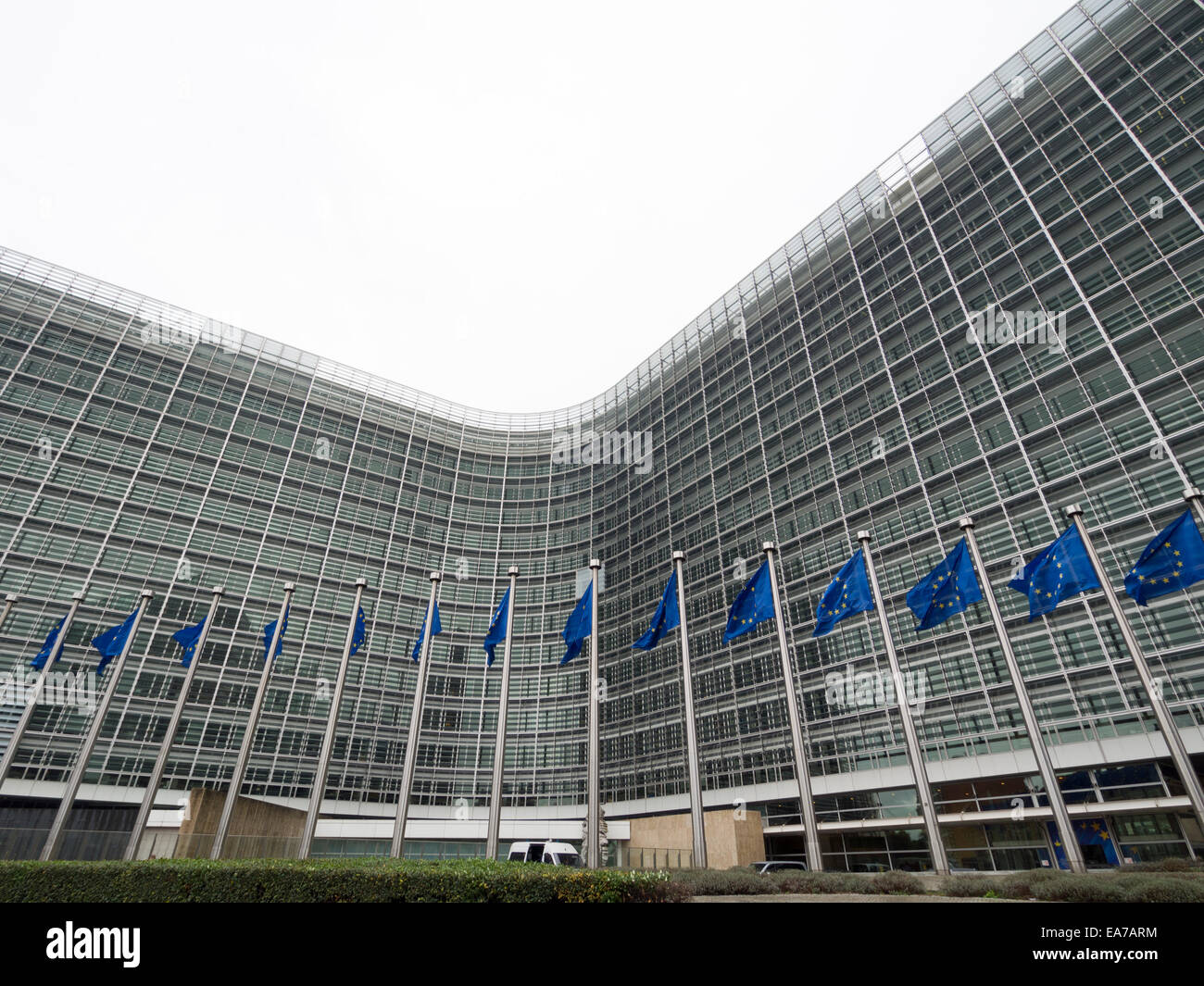 European Union flags in front of the Berlaymont building, headquarters of the European commission in Brussels, Belgium, Stock Photo
