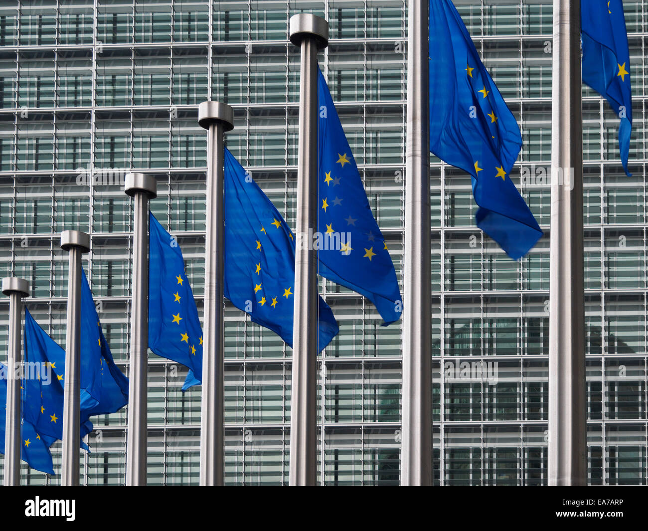 European Union flags in front of the Berlaymont building, headquarters of the European commission in Brussels, Belgium, - Stock Image