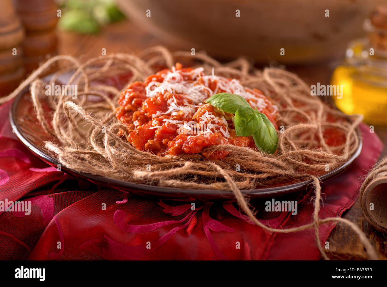 Food humour concept with spaghetti dinner made with twine. - Stock Image