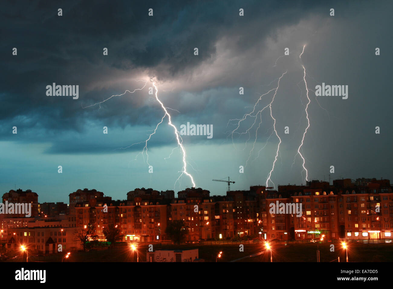 Lightning over night city during a lightning storm Stock Photo