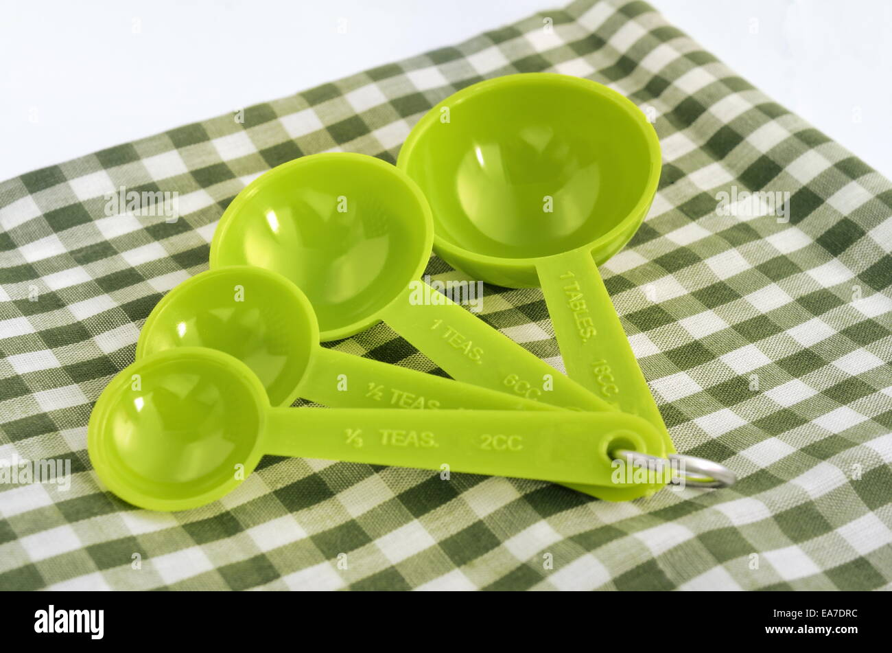 Measuring spoon set green color - Stock Image
