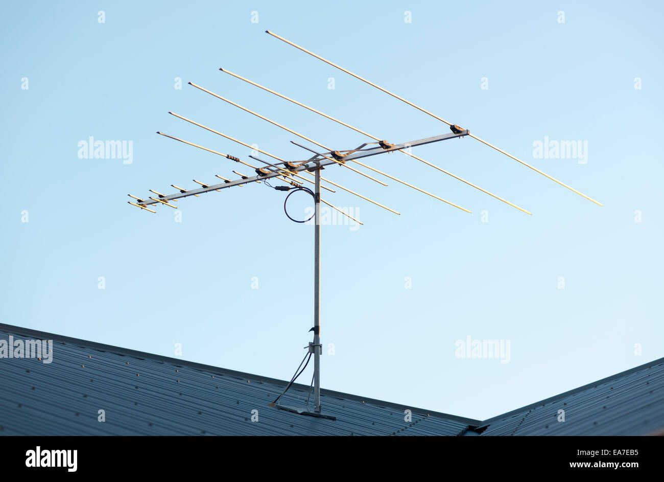 Digital TV aerial or antenna on top of a house - Stock Image
