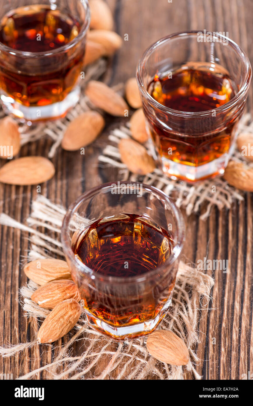 Some Amaretto Shots (close-up shot) on dark background - Stock Image