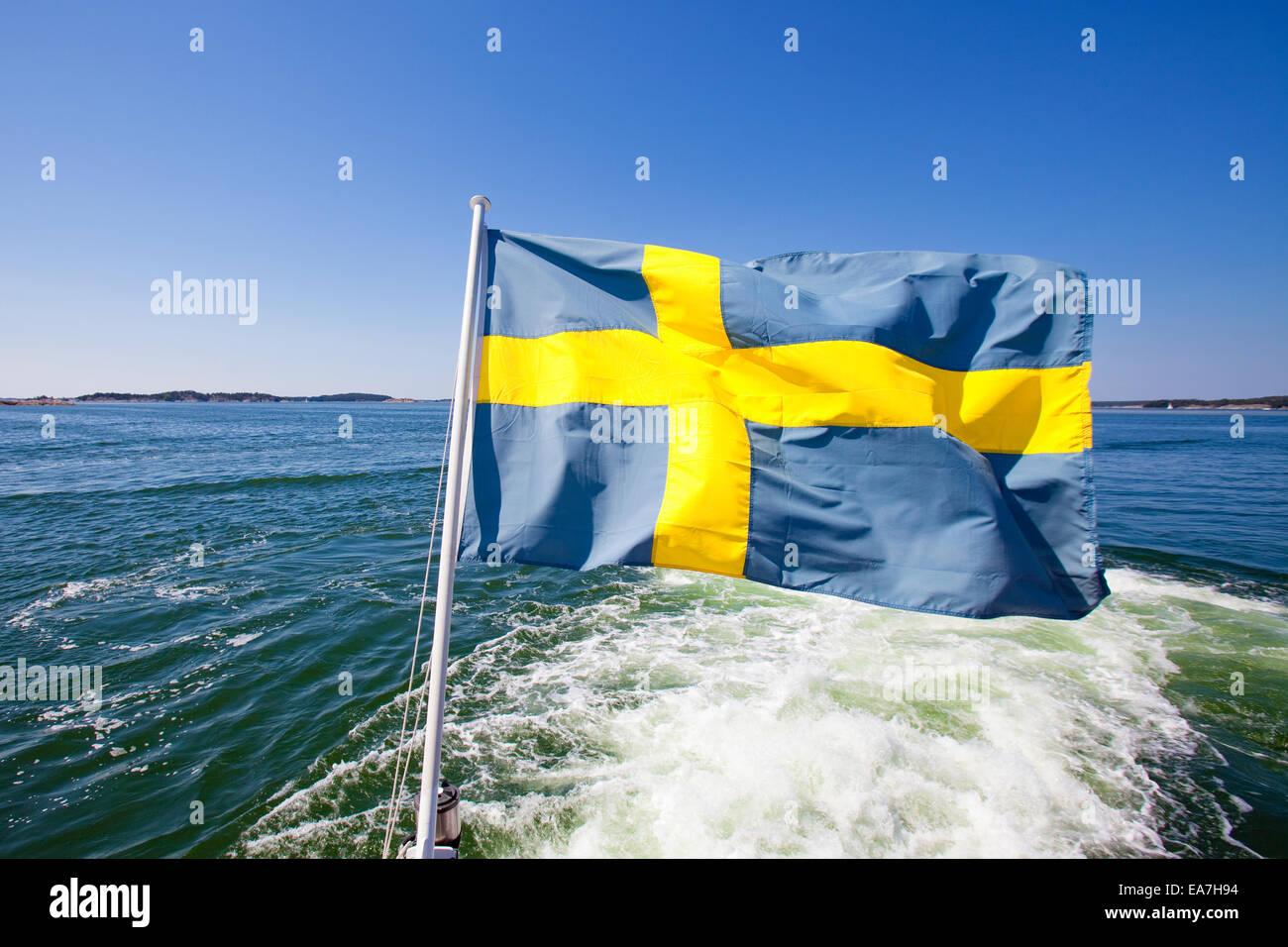Sweden, Stockholm Archipelago - Swedish Flag on a Ferry - Stock Image