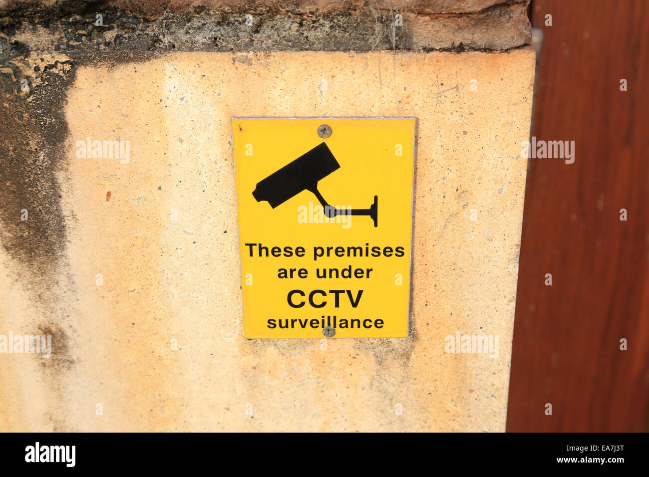 Sign warning that premises are under CCTV surveillance - Stock Image