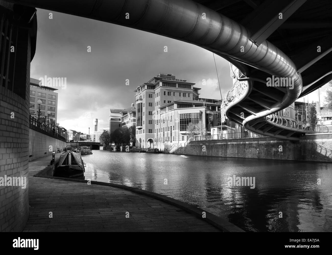 Urban landscape of the docks at Temple Quays in Bristol's Temple Quarter, in evening light, taken from below - Stock Image