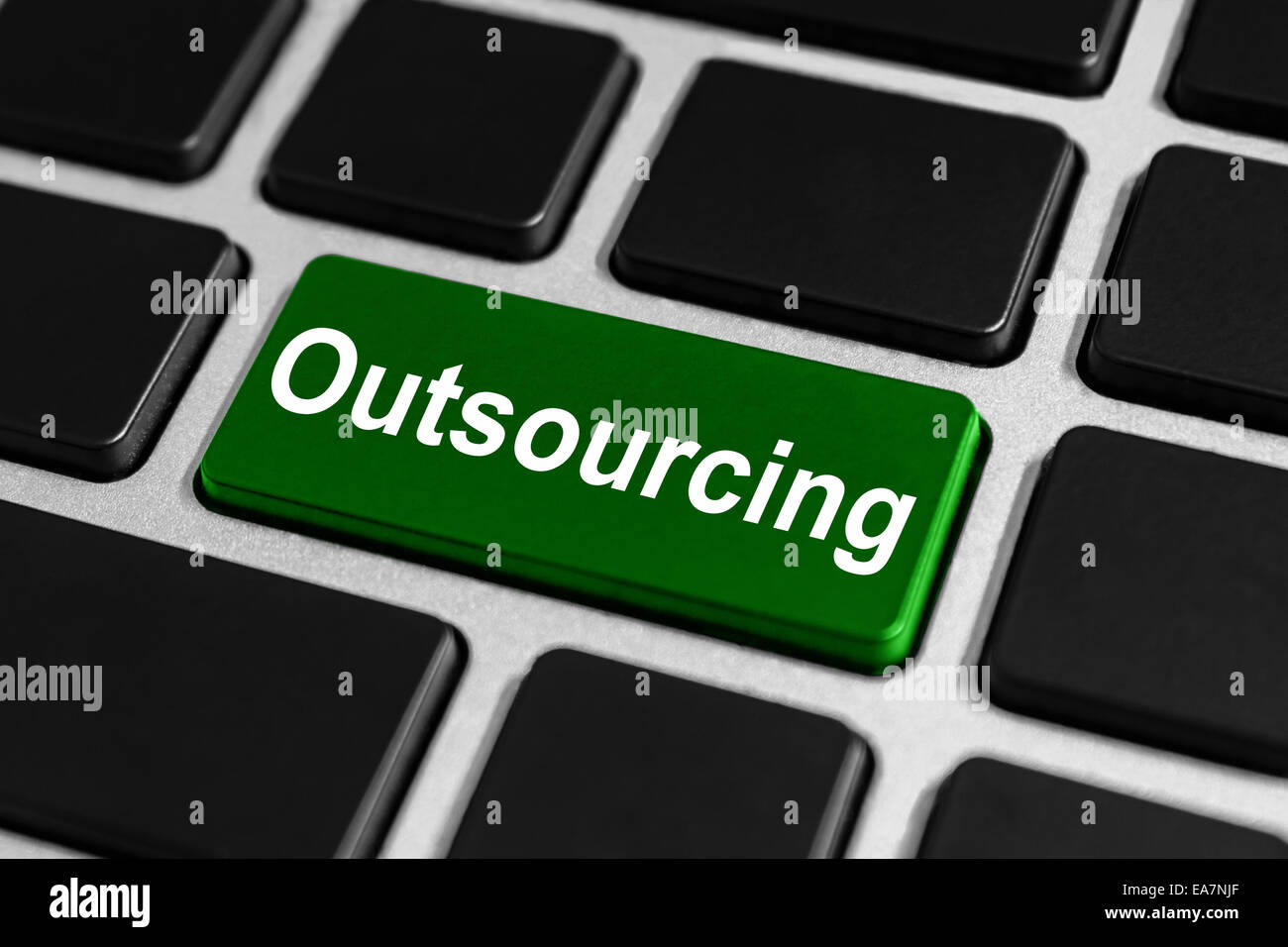 Outsourcing green button on keyboard, business concept - Stock Image