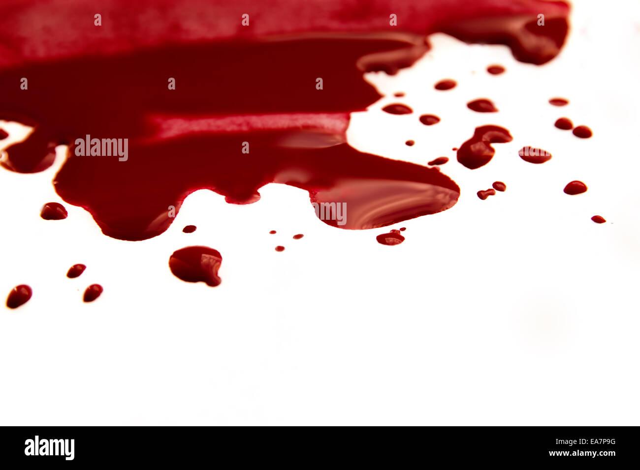 Blood stains (puddle, pool) isolated on white background close up, horizontal - Stock Image