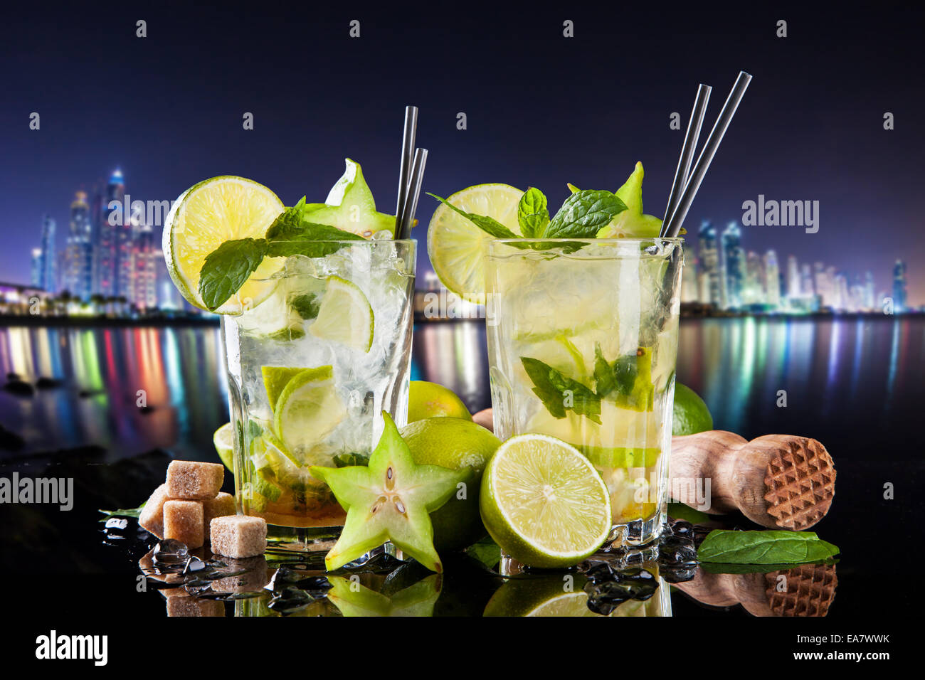 Summer drinks with blur night modern city on background - Stock Image