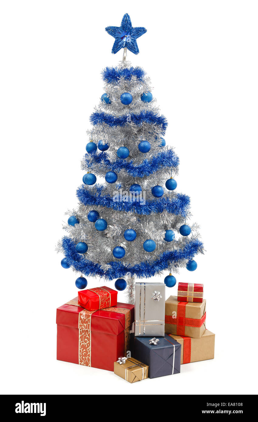 artificial silver christmas tree isolated on white decorated with blue ornaments and silver garland a lot of presents under th