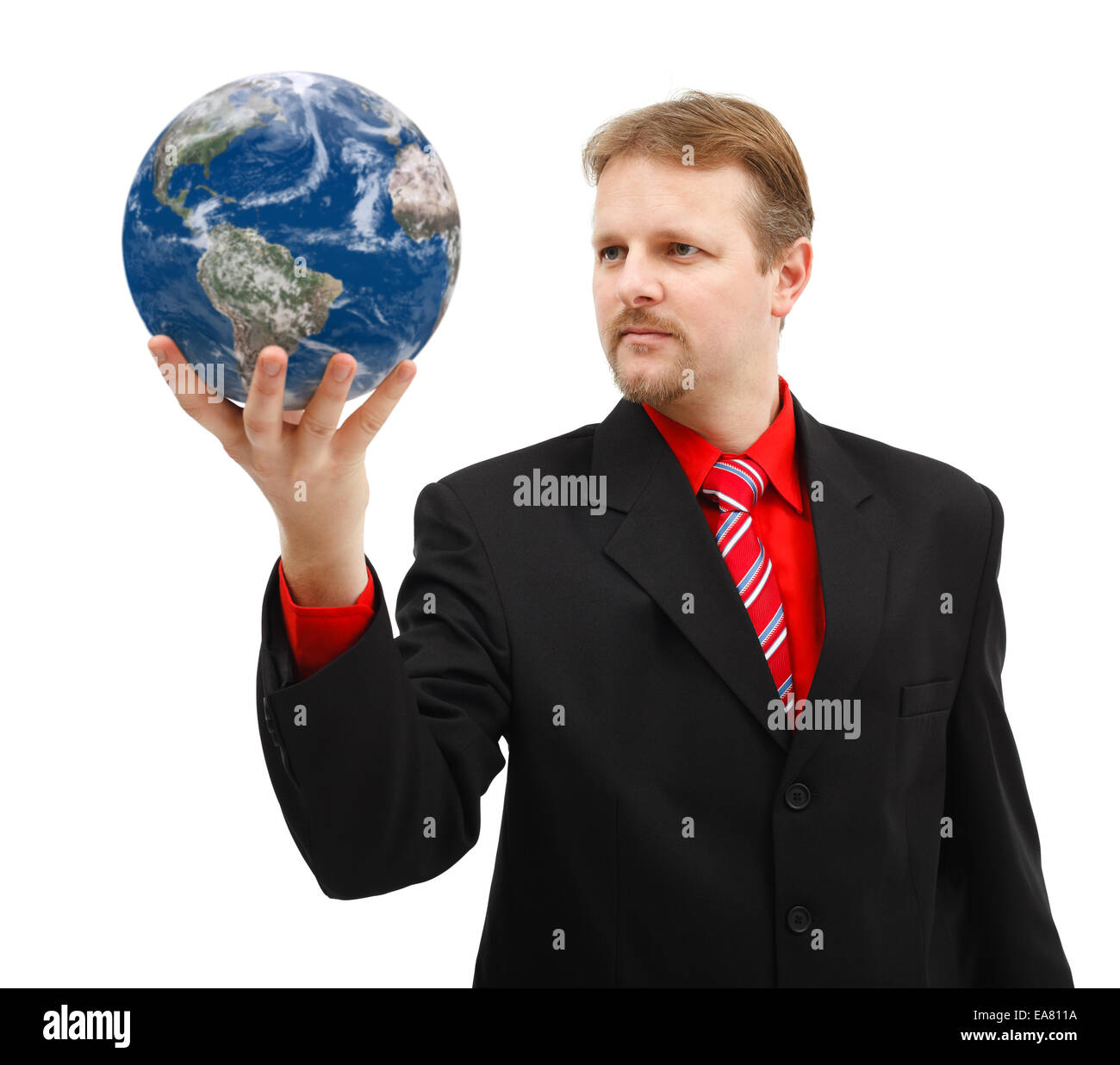 Powerful business man looking at Earth globe held in his hand - Stock Image