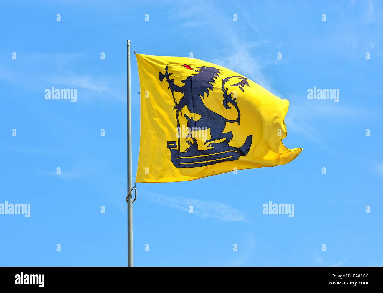 Flag of municipality Nieuwpoort in province West Flanders, Belgium, waving on the wind in clear day - Stock Image