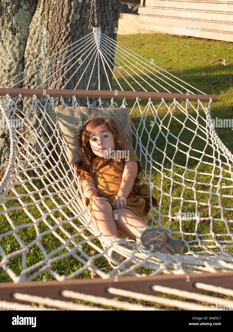 young girl in hammock on yard - Stock Image