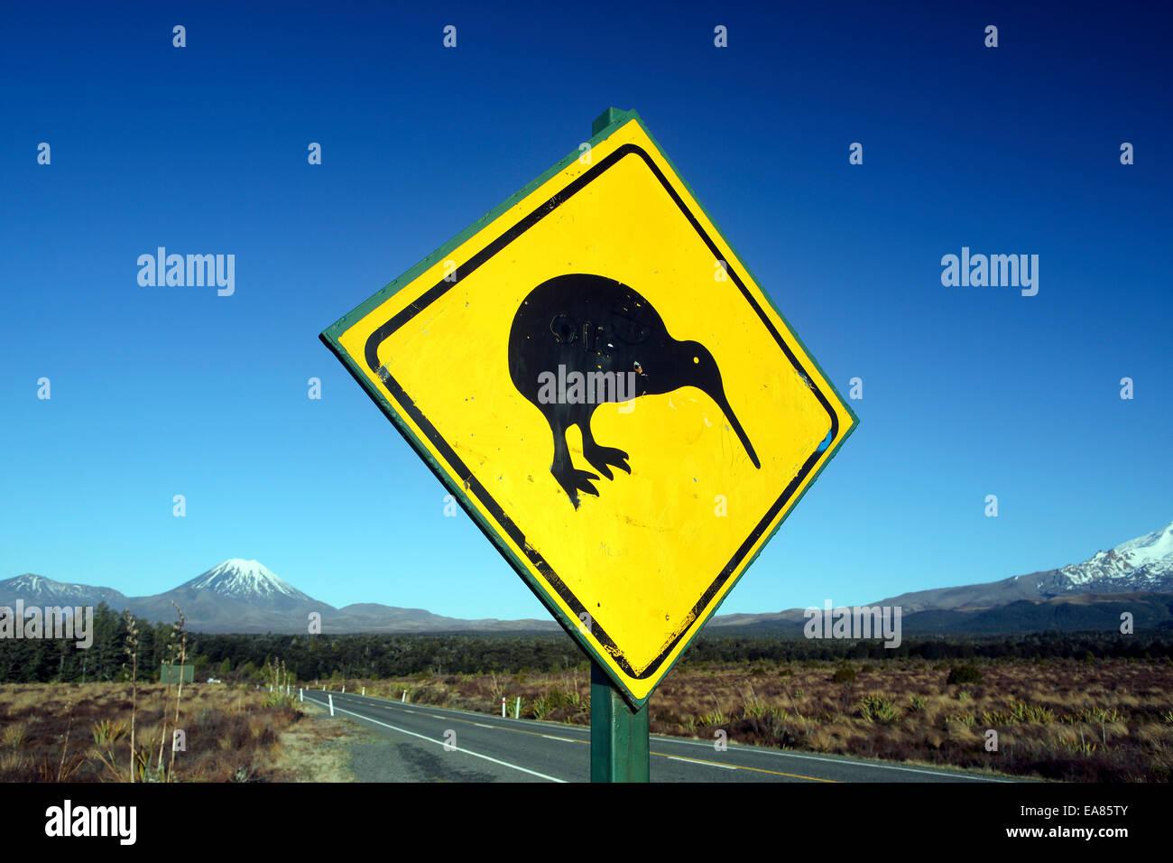 Kiwi road sign and Mount Ngauruhoe - Stock Image