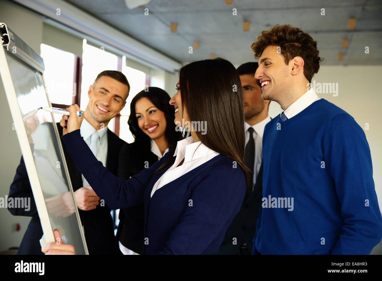 Happy business team with flip board in office Stock Photo