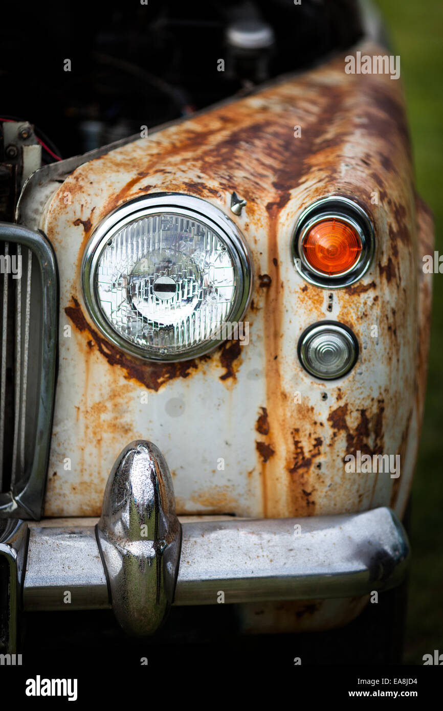 Vertical shot of the front part of classic vintage car ready to be ...
