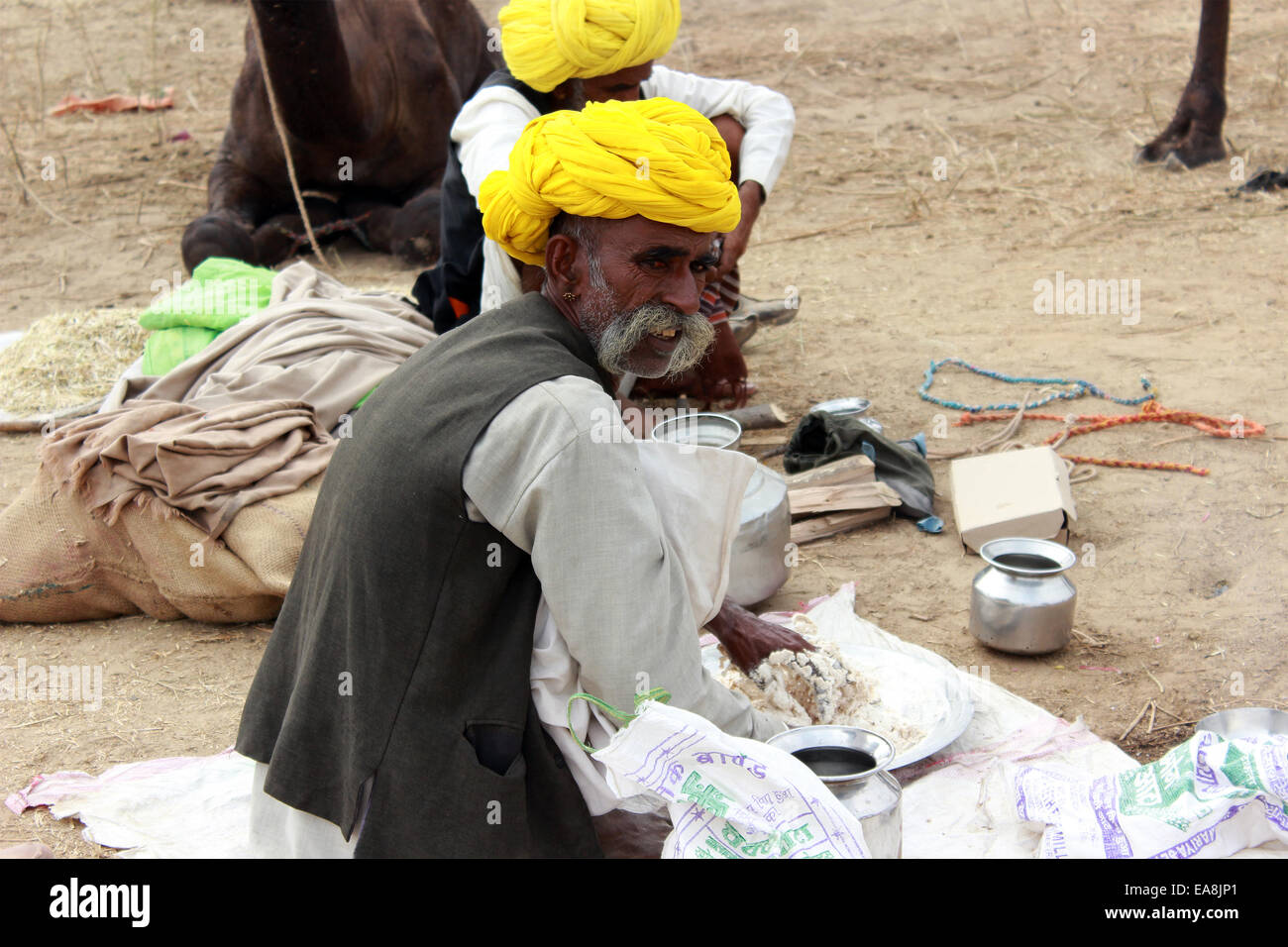 two, male, man, flair, siting, mix, turban, mustache in Pushkar, Rajasthan, India. - Stock Image