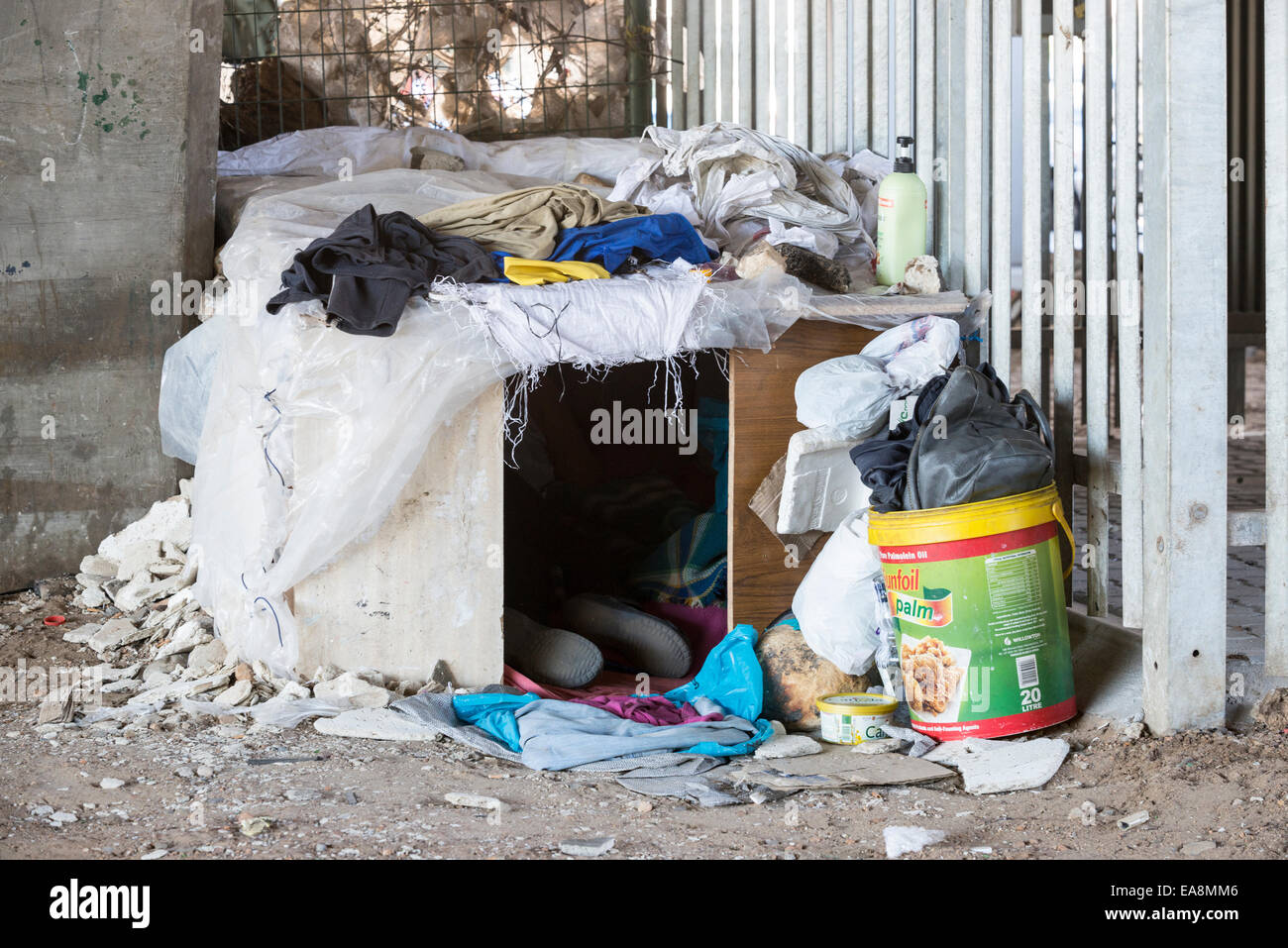 A homeless person sleeps in a makeshift shack, Cape Town, South Africa - Stock Image