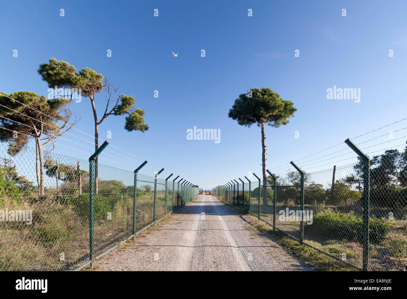 Viladecans. Walk between fences. - Stock Image