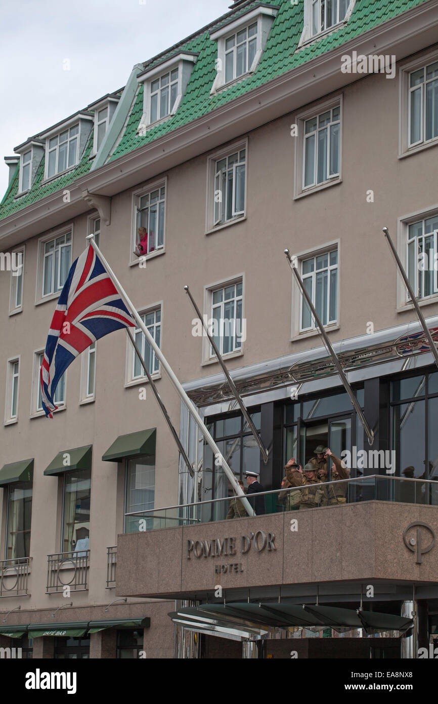 The Union Jack displayed on the Pomme d'Or balcony  during the Liberation Parade at St Helier Jersey - Stock Image