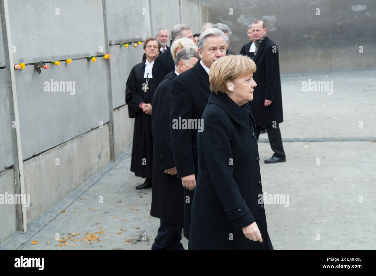 Chancellor Angela Merkel (CDU),and Klaus Wowereit  between others celebrits laying roses at Berlin Wall Memorial Stock Photo