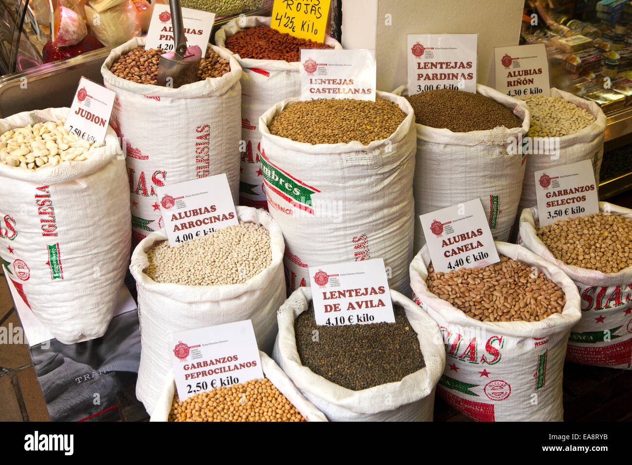 Sacks of beans and pulses on display in a market Bario Macarena, Seville, Spain - Stock Image