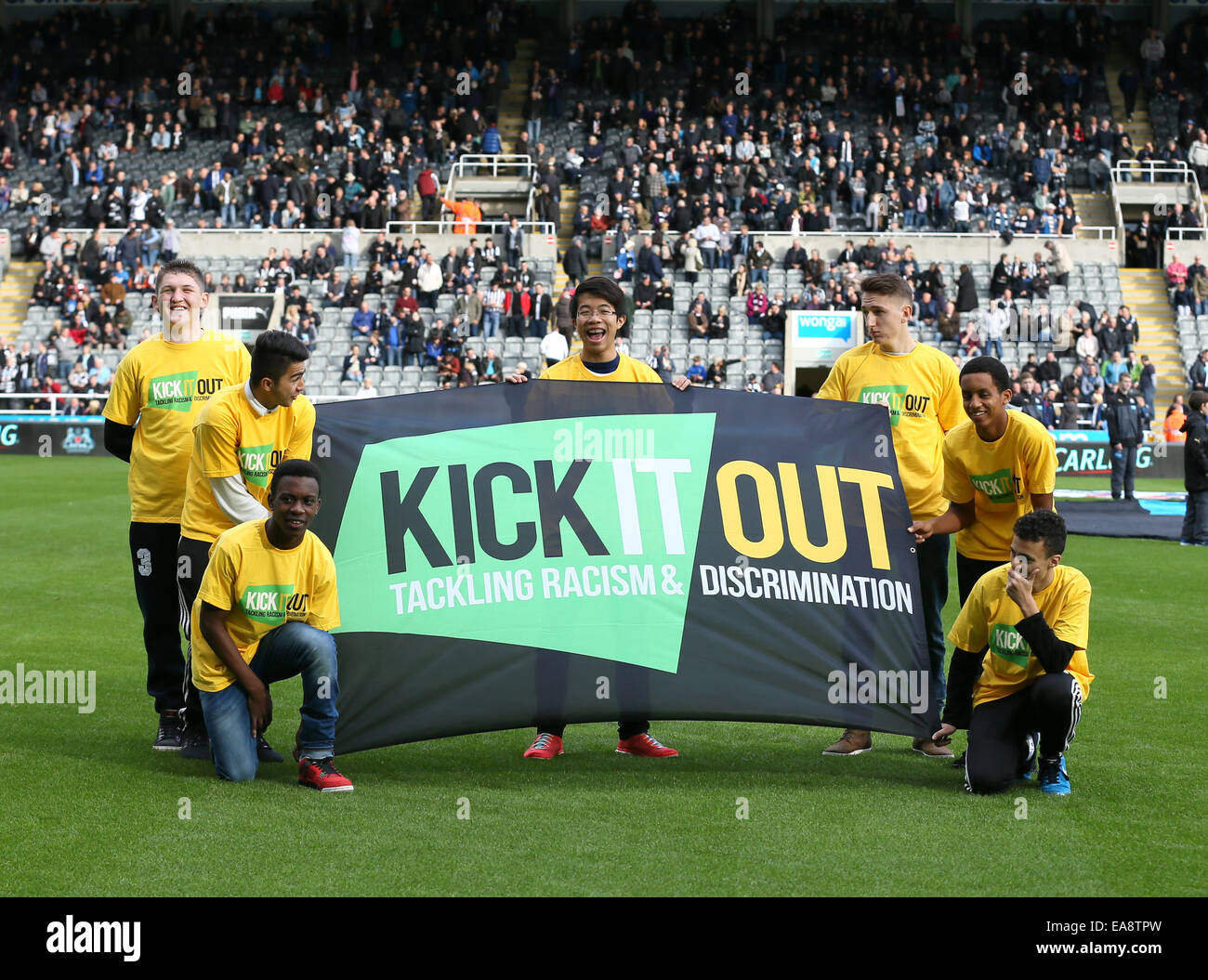 Newcastle, UK. 1st Nov, 2014. Children with a Kick it out anti racism poster - Barclays Premier League - Newcastle - Stock Image