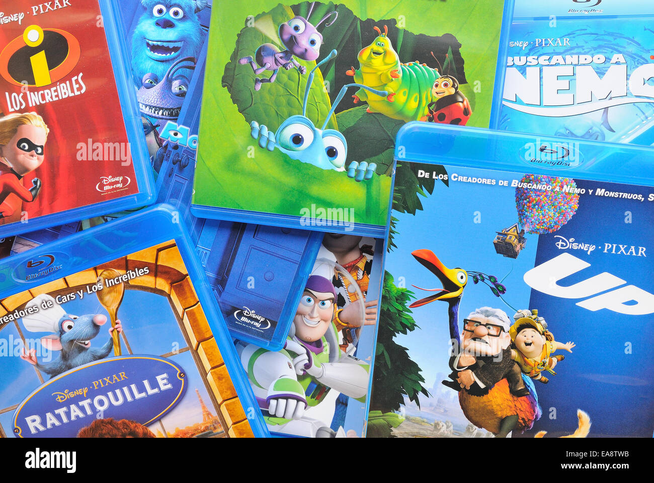 BARCELONA, SPAIN - APR 18, 2014: A collection of films by Disney Pixar Animation Studios on Blu-ray. - Stock Image