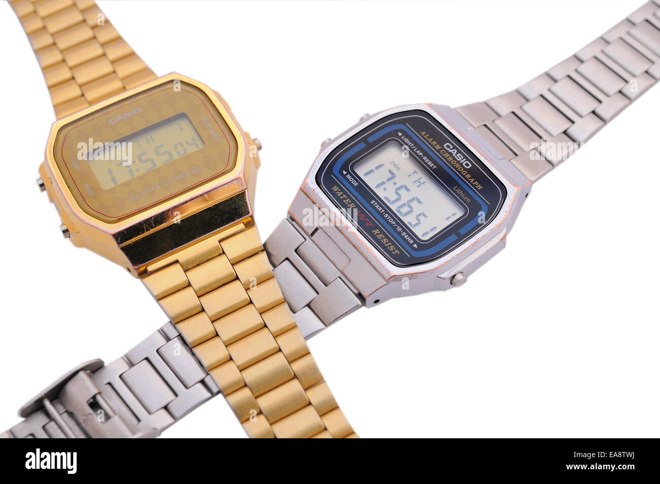 BARCELONA - JULY 12: Two intertwined Casio watches one in gold color and the other one in silver. - Stock Image