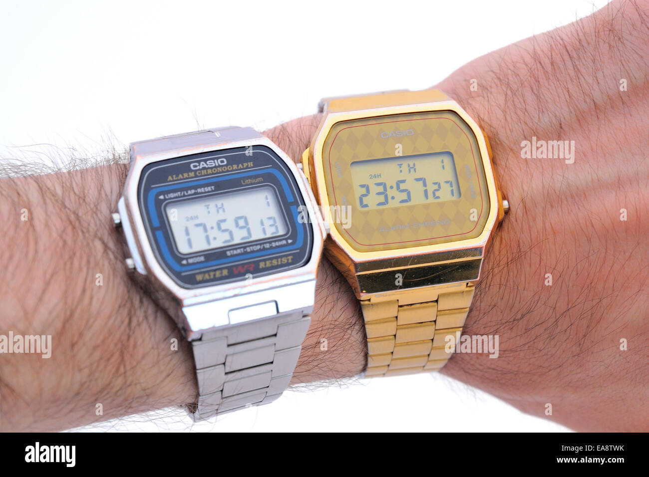 BARCELONA - JULY 12: A human wrist with a with two Casio watches, one in gold color and the other one in silver. - Stock Image
