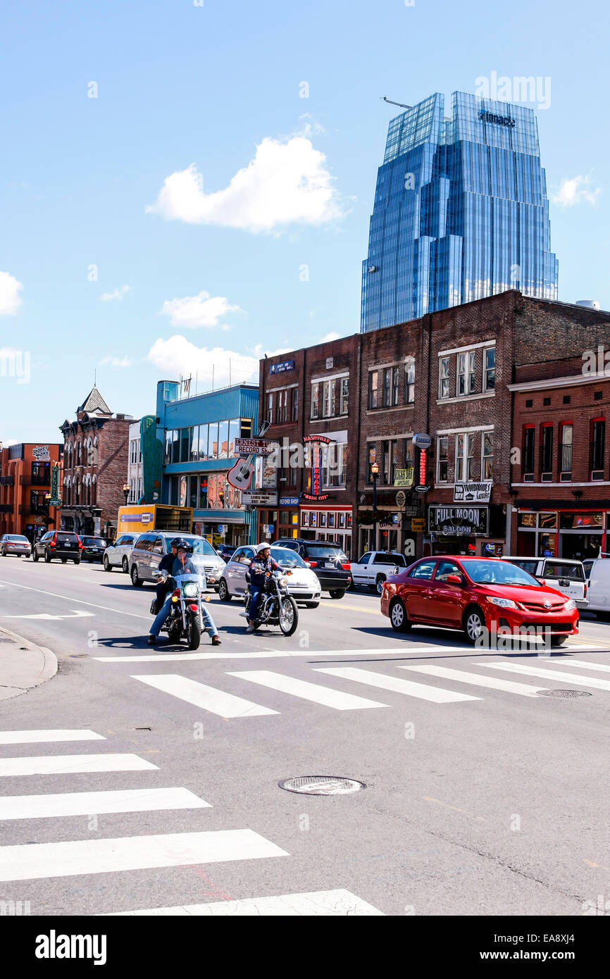 Lower Broadway in Nashville with the Pinnacle building in the background - Stock Image