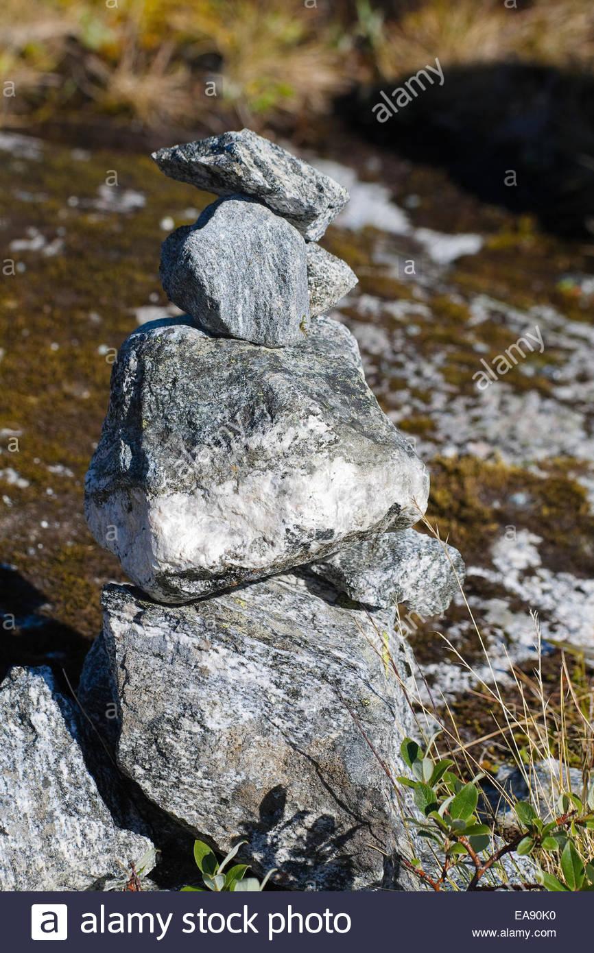 figures made of stone folded tourists Scandinavia Norway - Stock Image
