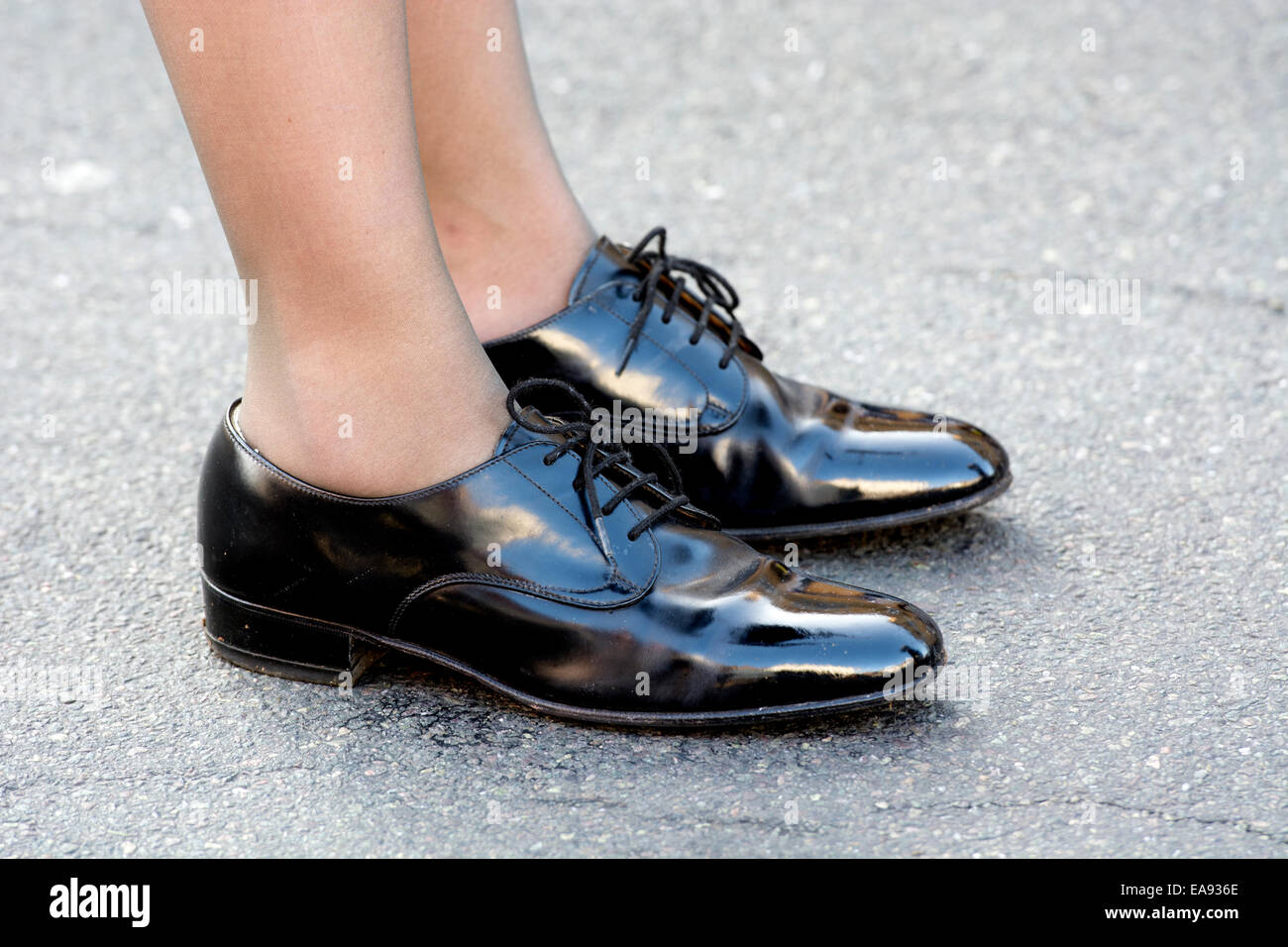 Stratford-upon-Avon Remembrance Sunday parade. Polished shoes of a female Air Training Corps band member. - Stock Image