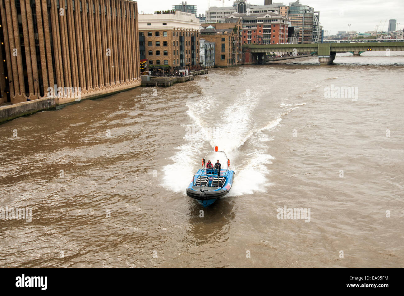 Blue Lightening RIB giving power boat rides to tourists on the River Thames in London - Stock Image
