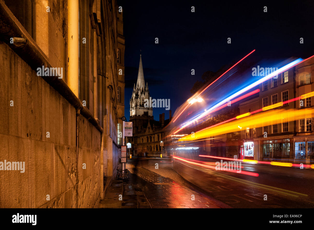 Oxford high street at night with streaks of light from a passing bus - Stock Image