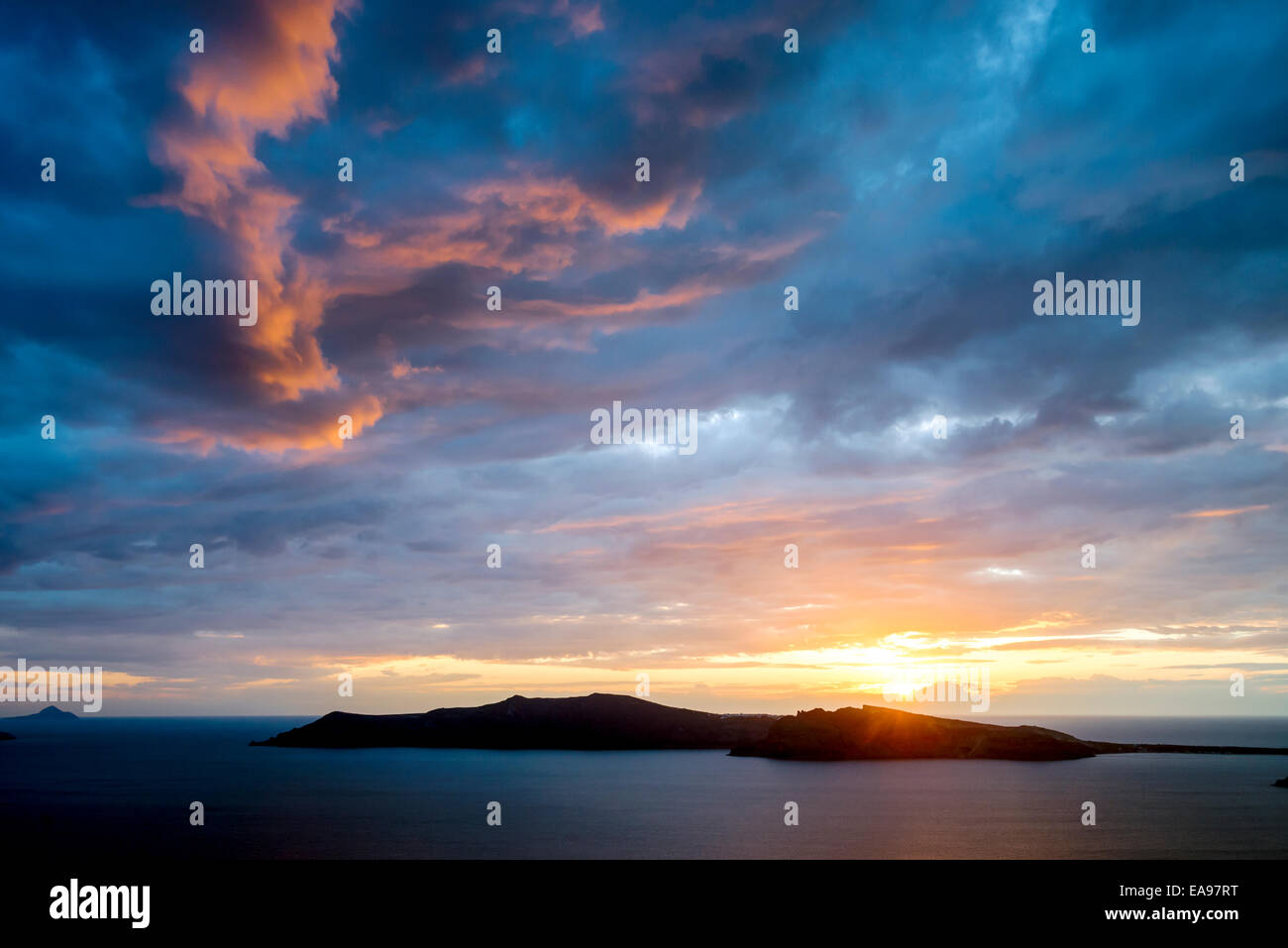 Spectacular sunset over the Aegean volcanic island caldera