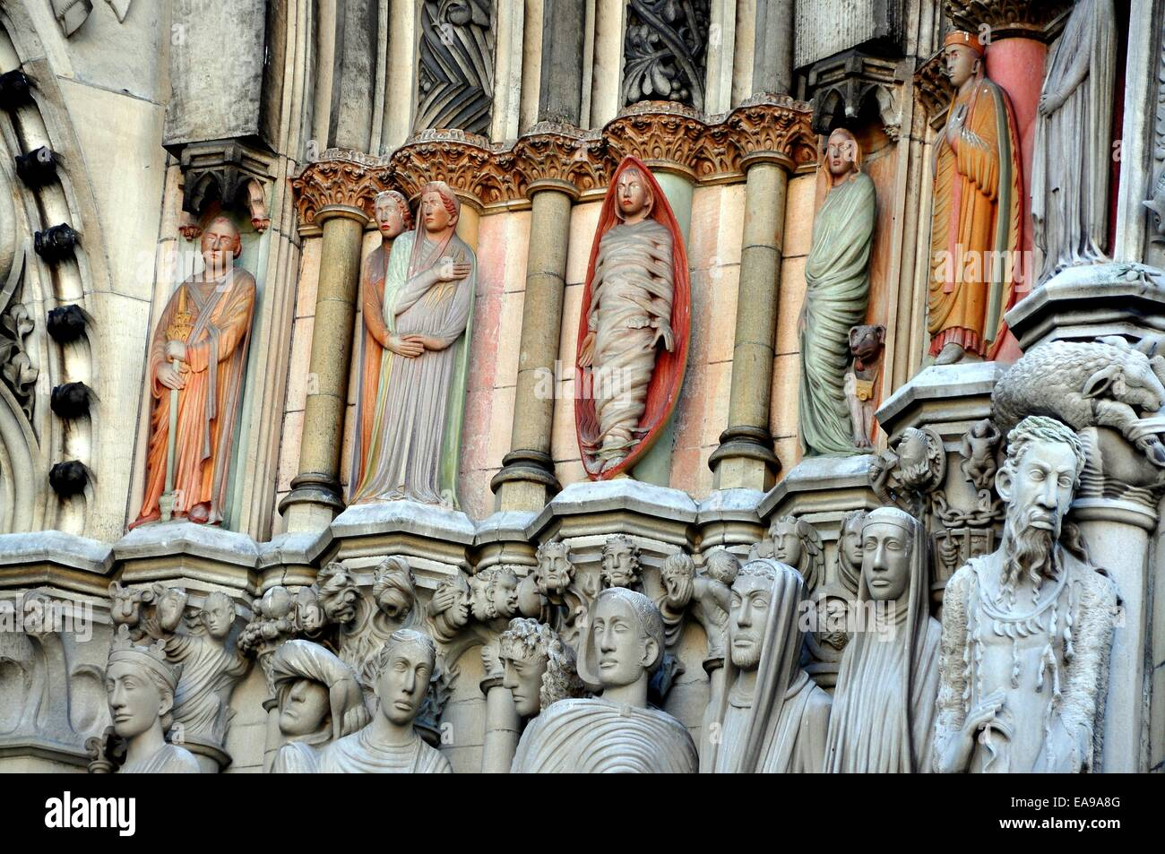 NYC:  Statues adorn the west front entrance doorways to the 1892 Cathedral Church of St. John the Divine - Stock Image