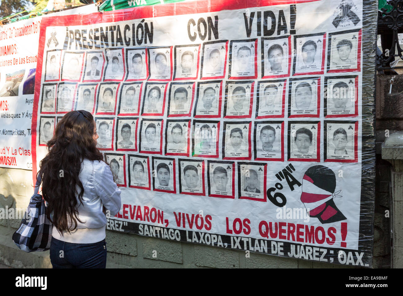 People view a banner demanding justice for the missing students believed executed by corrupt police hang from the - Stock Image