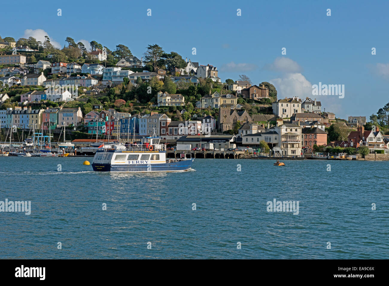 Dartmouth/Kingwear Ferry cruising along the River Dart  with a landscape view of  Kingswear in the background, South Stock Photo