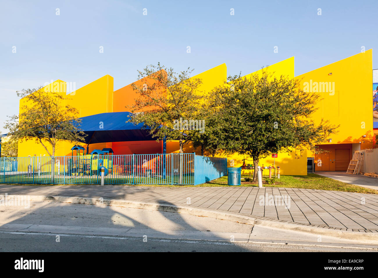 Brightly coloured colored Miami's Children's Museum fenced playground with shade awning in Miami Florida, USA. Stock Photo