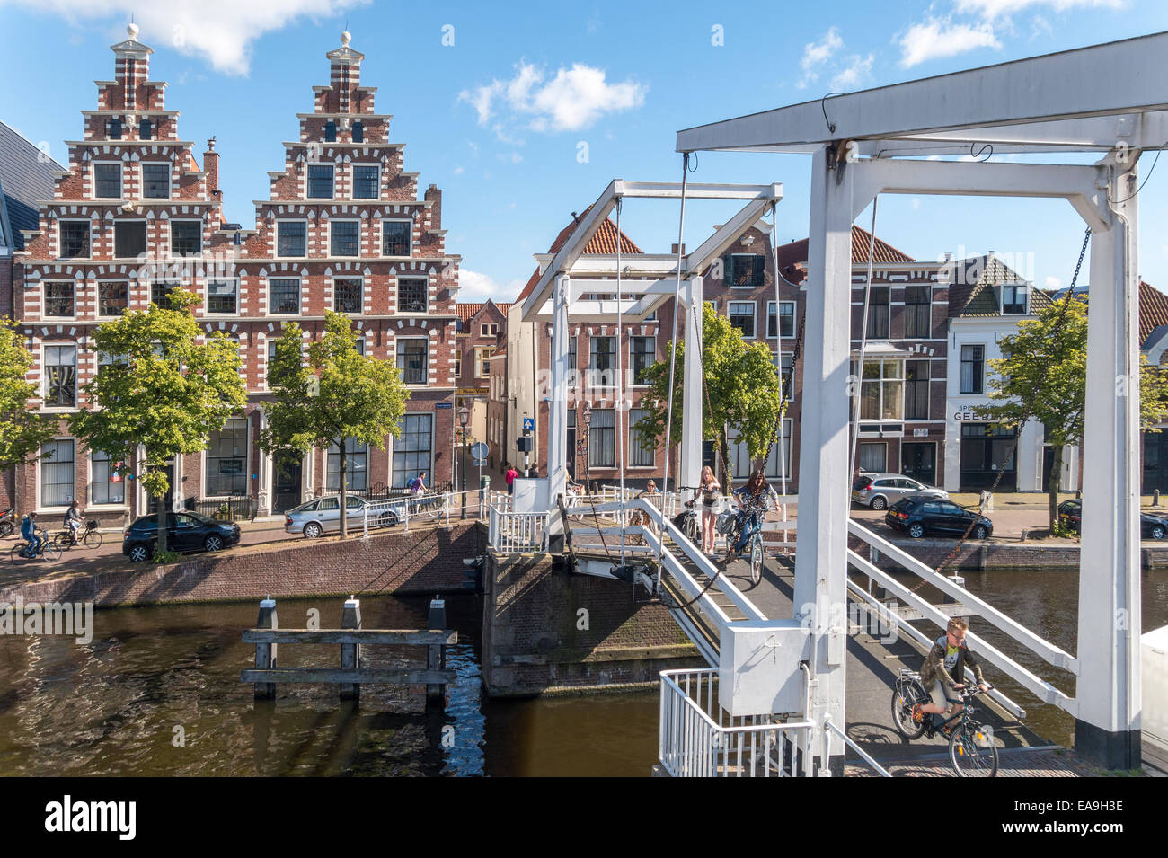 Haarlem drawbridge for bicycles bikes cycles. Gravestenen Bridge with former brewery The Olyphant (1606). River - Stock Image