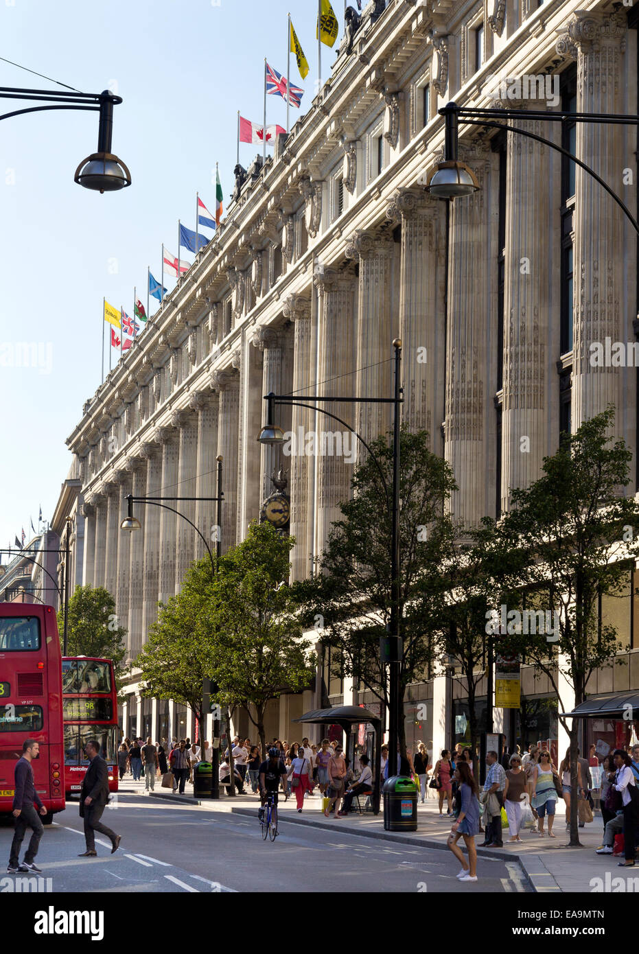 Oxford Street is the busiest shopping street in London, England and Selfridges is a large long established up-market - Stock Image