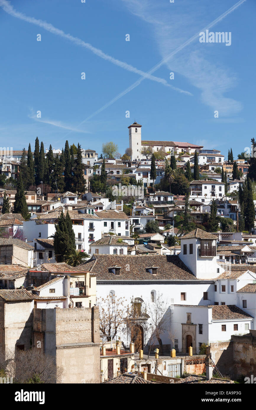 Albaicin (Albayzin) viewed from the slopes under the Alhambra, Granada, Spain. On the hill the church of Saint Nicholas, Stock Photo