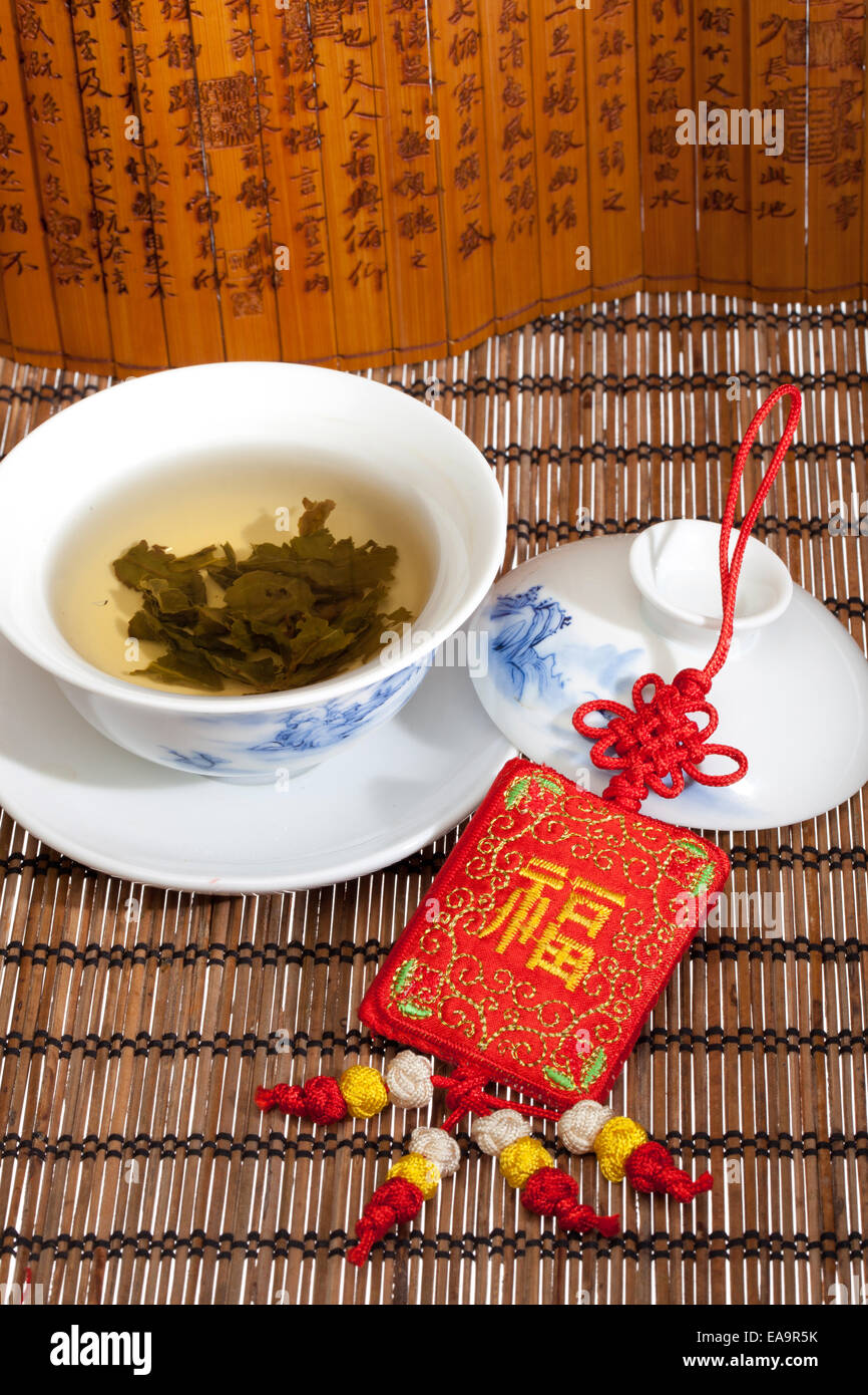 Tea cup nd sachet - Stock Image