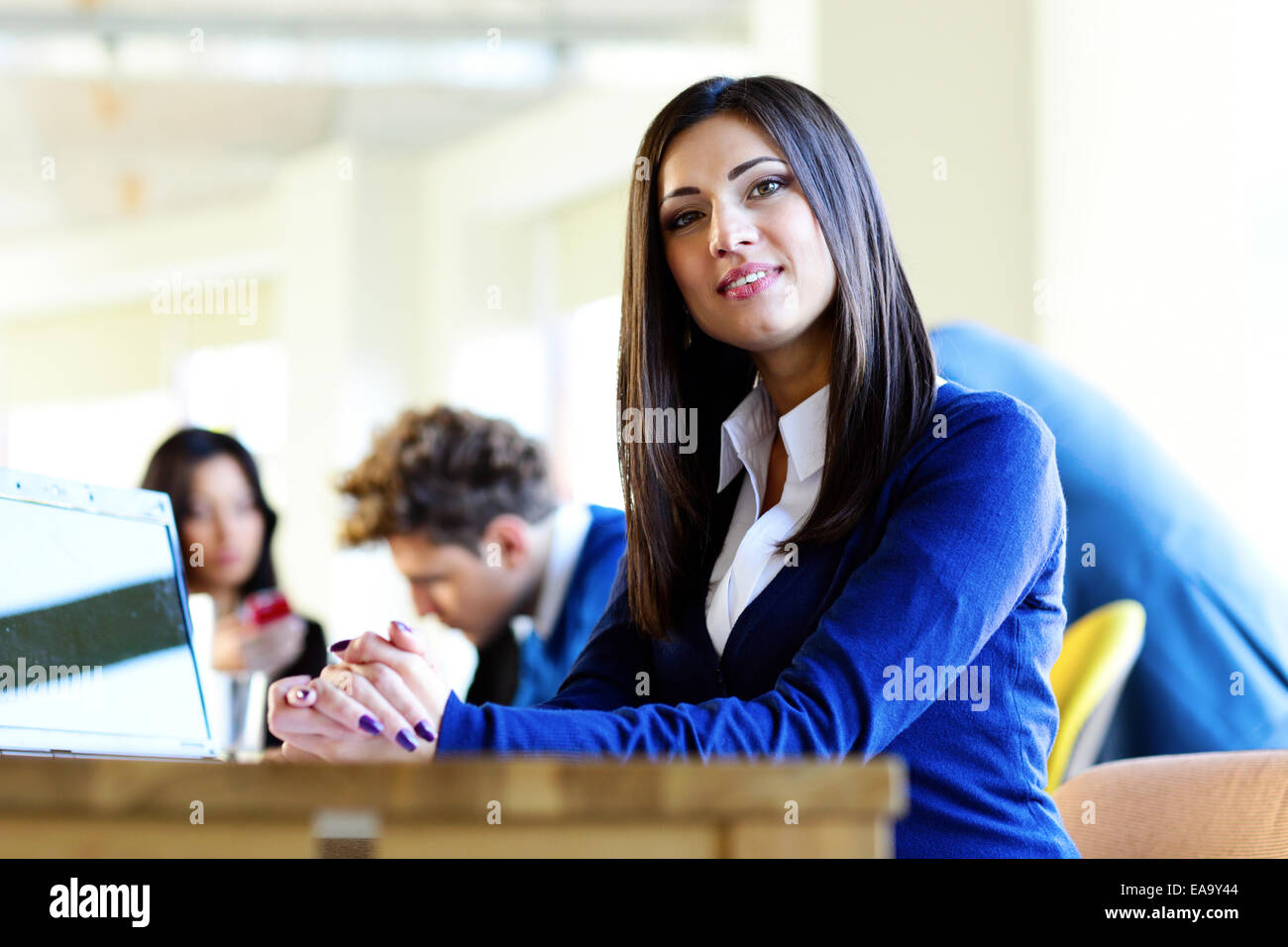 Happy beautiful businesswoman sitting at the table on a meeting - Stock Image